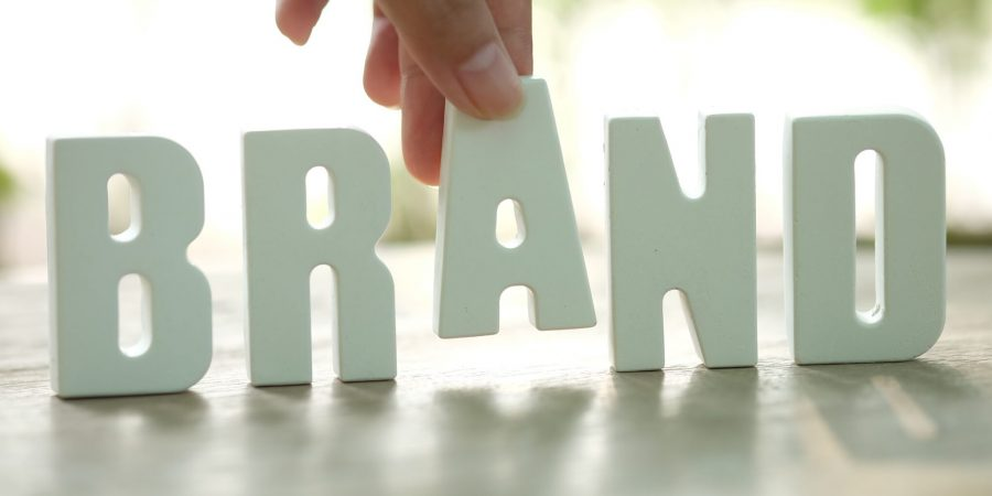 hand-arrange-white-letters-brand